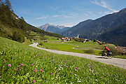 """Day 2 - Near Lenzerheide, flat valley in 3,500 feet climbing. - The author's friend and guide, Horst Hammerschmidt, pedals along an alpine valley in (XXXXX) during day two of their 10-day, 525-mile horseshoe-shaped loop over the country's highest passes. At the top of each climb, the duo rewarded themselves with a scrumptious dessert and dubbed the trip, """"sweet passes."""""""