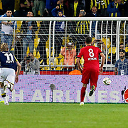 Fenerbahce's Emre Belozoglu (L) scores during their Turkish superleague soccer match Fenerbahce between Genclerbirligi at the Sukru Saracaoglu stadium in Istanbul Turkey on Saturday 25 October 2014. Photo by Aykut AKICI/TURKPIX
