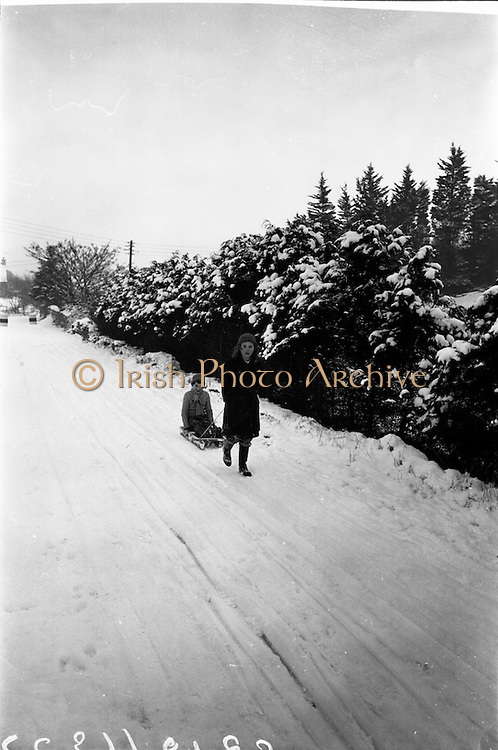13/01/1963<br /> 01/13/1963<br /> 13 January 1963<br /> Snow scenes from Kiliney and Dun Laoghaire, Co. Dublin. Children with sled.