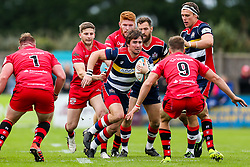 Rhodri Williams of Bristol Rugby is challenged by Kieran Hardy of Jersey Reds - Rogan/JMP - 28/10/2017 - RUGBY UNION - Stade Santander International - St Peter, Jersey - Jersey Reds v Bristol Rugby - Greene King IPA Championship.
