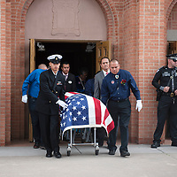 The casket of state Sen. John Pinto is led out of Sacred Heart Cathedral following the funeral Mass, Thursday, May 30 in Gallup.