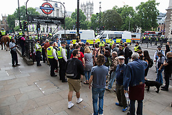 London, UK. 9th June, 2018. Police officers escort anti-fascists protest against the far-right March for Tommy Robinson into Westminster London Underground station in Parliament Street.
