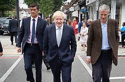 © Licensed to London News Pictures. 25/06/2019. London, UK. Conservative leadership candidate Boris Johnson (C)  campaigns in East Sheen in south west London with local MP Zac Goldsmith (R). Mr Johnson is campaigning in various locations in the south east of England today. Photo credit: Peter Macdiarmid/LNP