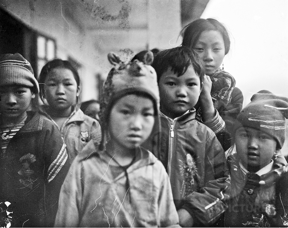 Outdated film picture of pupils looking at camera while photographed, Ha Giang Province, Vietnam, Southeast Asia