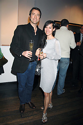 DR TREE RICHARDSON and JAMES SUNDSTAD at a private view of paintings by Lita Cabellut and Russian artist Yuri Kuper at Opera Gallery, 134 New Bond Street, London on 2nd April 2008.<br /><br />NON EXCLUSIVE - WORLD RIGHTS