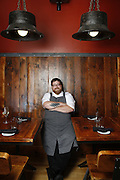 SHOT 8/15/13 4:36:06 PM - Justin Brunson, Owner and Executive Chef at Old Major restaurant in Denver, Co. Includes images of menu items : The Nose to Tail Plate : confit rib, pork chop, crispy belly, city ham, crispy ear, Denver Bacon Co. barbecue beans, cole slaw and corn bread $29 and Pan Seared Scallops : baby vegetables, fregola, spinach purée, toasted pine nuts, roasted garlic vinaigrette $27. The restaurant focuses on heritage-raised meats from Colorado farms, features an in-house butchery program and bills itself as contemporary farmhouse cuisine. (Photo by Marc Piscotty / © 2013)