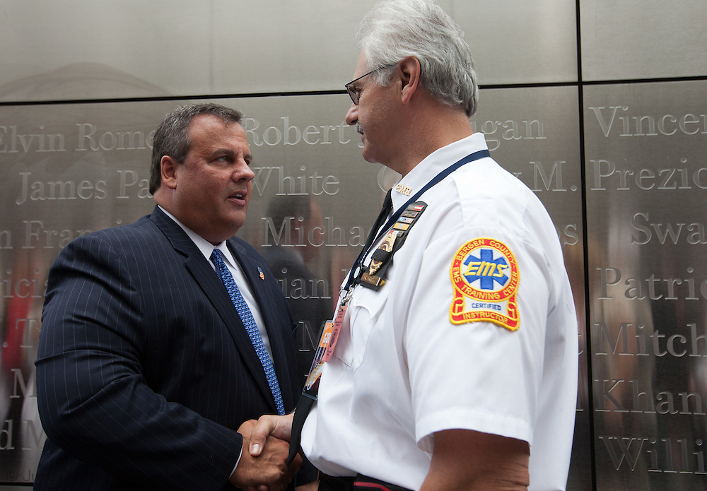 Governor Chris Christie  greats people during  the dedication ceremony of the  Empty Sky  9/11 Memorial at Liberty State Park in New Jersey  on September 10, 2011 . <br /> The memorial is two 30-Ft rectangular towers  208 feet by 10 inches long,  the width of the World Trade Center towers and with the names of the 746 New Jerseyans who perished after the terrorist attacks on 9/11, 2001  etched in stainless steel