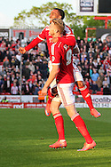 Swindon Town's Michael Smith celebrates their 3rd goal with Nathan Thompson during the Sky Bet League 1 Play Off Second Leg match between Swindon Town and Sheffield Utd at the County Ground, Swindon, England on 11 May 2015. Photo by Shane Healey.