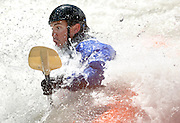 Dino Madsen gets deep in Taco Hole during the Wyoming Whitewater Championships on Saturday. The Snake River provides the perfect playground for the event as spectators cheer on both novice and expert paddlers while they shred the roaring whitewater and attempt technical tricks like loops and flat spins. Madsen placed third in the recreational division.