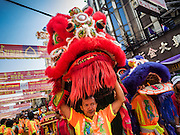 "08 FEBRUARY 2016 - BANGKOK, THAILAND:  Lion dancers perform for Chinese New Year on Yaowarat Road in Bangkok's Chinatown district, during the celebration of the Lunar New Year. Chinese New Year is also called Lunar New Year or Tet (in Vietnamese communities). This year is the ""Year of the Monkey."" Thailand has the largest overseas Chinese population in the world; about 14 percent of Thais are of Chinese ancestry and some Chinese holidays, especially Chinese New Year, are widely celebrated in Thailand.      PHOTO BY JACK KURTZ"