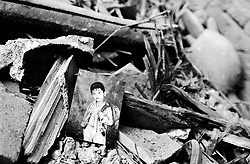 Old school photo in debris of demolished house in a hutong in Beijing