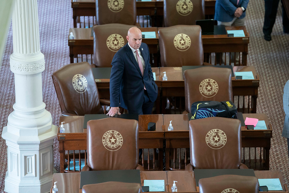 State Rep. Jake Ellzey, R-Waxahachie, sits among empty chairs as Republican Texas House members work in the chamber on the second day of failing to get a quorum at a special session. Most Democratic members left the state protesting of restrictive voting measures proposed byTexas Gov. Greg Abbott.