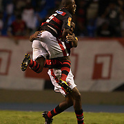 Renato of Flamengo is congratulated by team mate Toro (5) after scoring his sides third goal from a blistering free kick during the Flamengo V  Fluminense, Futebol Brasileirao  League match at Estadio Olímpico Joao Havelange, Rio de Janeiro, The classic Rio derby match ended in a 3-3 draw. Rio de Janeiro,  Brazil. 19th September 2010. Photo Tim Clayton