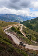 An old truck in Nagorno-Karabakh ascends a winding road leading to the Sotk Pass at the border with Armenia.