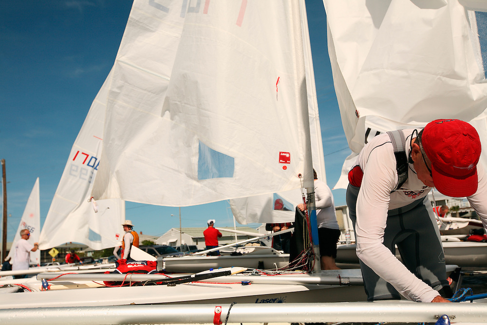 Sailors pack up their equipment after races at the Laser National Championships at the Carolina Yacht Club on Wrightsville Beach, NC.