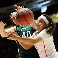 031314  Adron Gardner/Independent<br /> <br /> Ashley John (33) knocks away a ball from Shelby Perry (40) during the state high school basketball tournament at The Pit in Albuquerque Thursday.