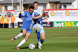 Peterborough United's Nicky Ajose in action with Coventry City's David Prutton  - Photo mandatory by-line: Joe Dent/JMP - Mobile: 07966 386802 12/04/2014 - SPORT - FOOTBALL - Peterborough - London Road Stadium - Peterborough United v Coventry City - Sky Bet League One