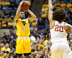 Jan 20, 2018; Morgantown, WV, USA; West Virginia Mountaineers guard James Bolden (3) shoots a three pointer during the second half against the Texas Longhorns at WVU Coliseum. Mandatory Credit: Ben Queen-USA TODAY Sports