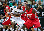 SHOT 2/23/10 9:13:56 PM - Colorado State's Travis Franklin looks to pass as New Mexico's Will Brown (#15) and Roman Martinez (#30) close in on defense during the first half of their regular season Mountain West Conference game at Moby Arena in Fort Collins, Co. New Mexico survived a tight game winning 72-66. (Photo by Marc Piscotty / © 2010)