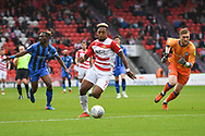 Mallik Wilks of Doncaster Rovers (7) nips past the stranded Tomáš Holý of Gillingham (1) - but Mallik Wilks of Doncaster Rovers (7) is offside - during the EFL Sky Bet League 1 match between Doncaster Rovers and Gillingham at the Keepmoat Stadium, Doncaster, England on 20 October 2018.