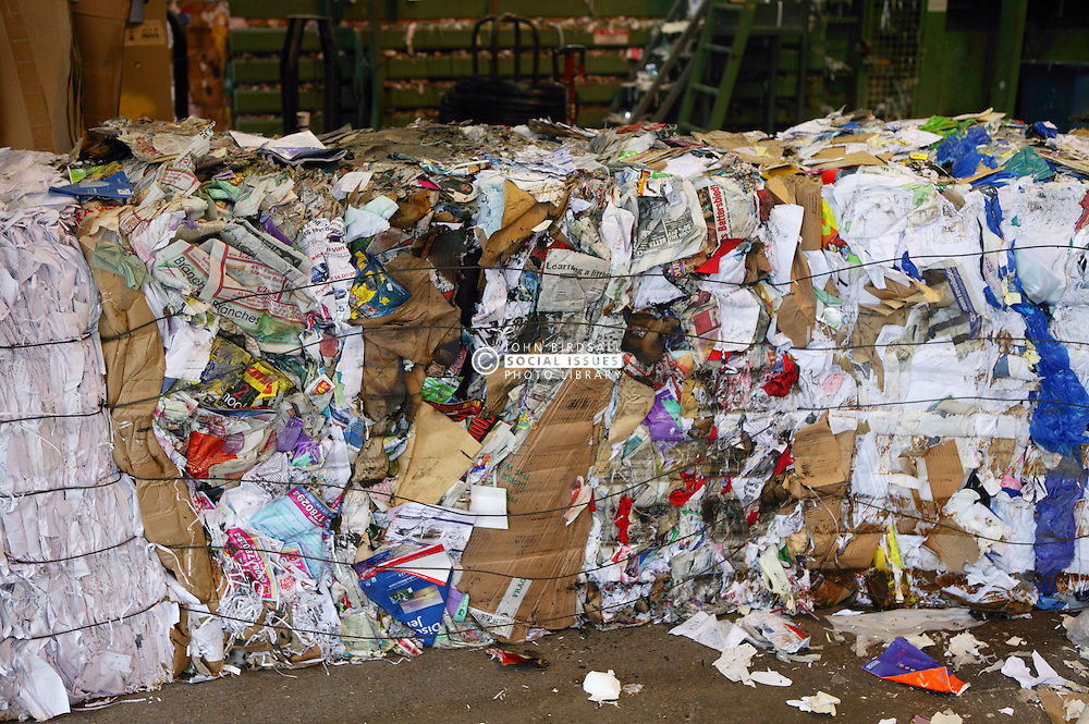 Assortment of cardboard and paper at collection point before sorting and grading,