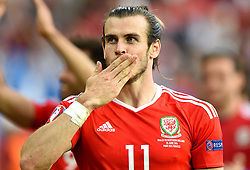 Gareth Bale of Wales celebrates with Wales fans after the game  - Mandatory by-line: Joe Meredith/JMP - 25/06/2016 - FOOTBALL - Parc des Princes - Paris, France - Wales v Northern Ireland - UEFA European Championship Round of 16