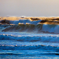 Pacific Ocean waves crash ashore at Montara  State Beach near San Francisco, California.