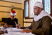 A schoolboy reads verses from the Koran in front of his religious teacher in a classroom at the Islamic Koom al-Bourit Institute for Boys in the village of Qum (Koom), on the West Bank of Luxor, Nile Valley, Egypt.