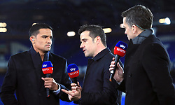 Everton manager Marco Silva (centre) speaks to Sky Sports presenter David Jones (right) and pundit Tim Cahill after the Premier League match at Goodison Park, Liverpool.