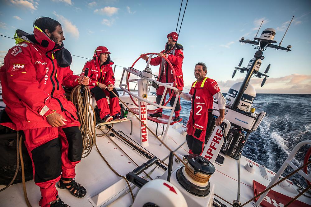 Leg 02, Lisbon to Cape Town, day 14, on board MAPFRE, Blair Tuke, Sophie Ciszek, Pablo Arrarte and Joan Vila  talking after having got an fleet update. Photo by Ugo Fonolla/Volvo Ocean Race. 18 November, 2017