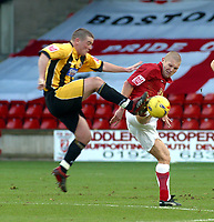 Photo: Dave Linney.<br />Walsall v Boston United. Coca Cola League 2. 27/01/2007.<br />Walsall's Michael Dobson (c) in high kicking action with Boston's  Stephen Vaughan.