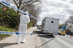 © Licensed to London News Pictures . 30/04/2013 . Salford , Greater Manchester , UK . Police and forensic scenes of crime examiners at the scene on Regent Road , Salford , where a prison van was hijacked this morning (Tuesday 30th April) . Police report that two prisoners escaped . Photo credit : Joel Goodman/LNP