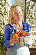 Rebecca Bent with basket of fresh fruit in solarium of relatives' home in Manhasset, New York, USA, on January 30, 2014