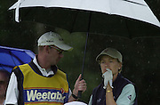 Sat 4th August 2001.Catriona Matthew, shelters under the umbrella. while waiting to tee off the 11th.2001 Weetabix Women's Open, Sunningdale,..[Mandatory Credit Peter Spurrier/ Intersport Images]