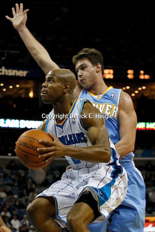 January 6, 2012; New Orleans, LA, USA; New Orleans Hornets point guard Jarrett Jack (2) drives past Denver Nuggets small forward Danilo Gallinari (8) during the first quarter of a game at the New Orleans Arena.   Mandatory Credit: Derick E. Hingle-US PRESSWIRE