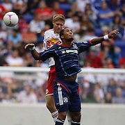 Sherjill MacDonald, Chicago Fire, is challenged by Markus Holgersson, New York Red Bulls, during the New York Red Bulls V Chicago Fire Major League Soccer regular season match at Red Bull Arena, Harrison. New Jersey. USA. 6th October 2012. Photo Tim Clayton