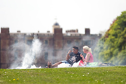 © Licensed to London News Pictures. 17/05/2016. Leeds UK. A couple enjoy a bbq in the ground's of Temple Newsam house in Leeds as Yorkshire see's another fine weather day. Photo credit: Andrew McCaren/LNP