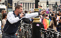 a lone anti pride protester  films himself giving the finger to the Reclaim Pride protest in London. It marched from Parliament Square to Hyde Park The demonstration demanded LGBT+ liberation and for Boris Johnson and his Tory government to stop stalling on LGBT+ rights