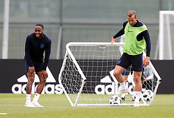 England's Raheem Sterling (left) and Harry Kane during the training session at the Spartak Zelenogorsk Stadium, Repino.