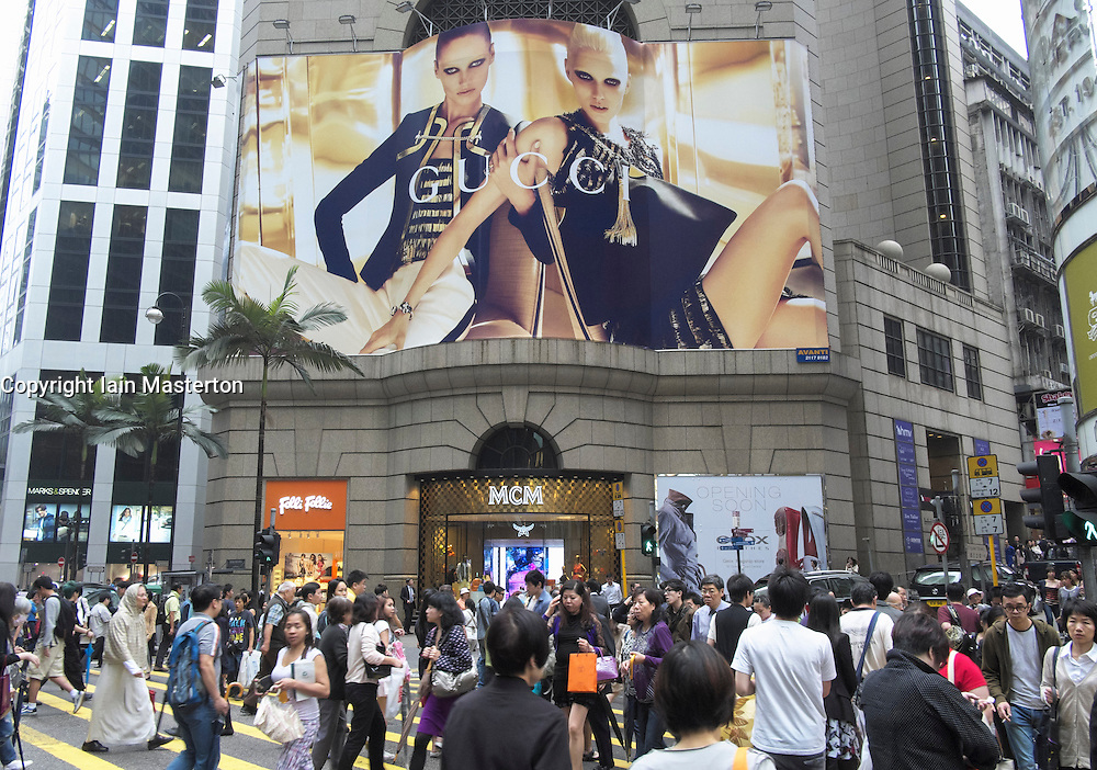 Busy street crossing with large advertising billboard to rear  in Central District in Hong Kong