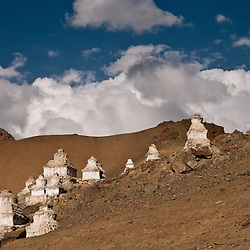 A stupa is a mound-like structure containing Buddhist relics, typically the remains of Buddha, used by Buddhists as a place of worship.