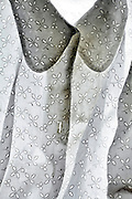 detail of a white shirt with embedded floral embroidery decoration