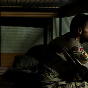 """Platoon Commander Geir Nes of Norway, waits at the ISAF bunks at Kabul International Airport to be returned to a Forward Operating Base in Afghanistan. """"I don't like it here, in-between,"""" he said. ltqmb"""