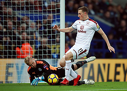 """Burnley's Chris Wood (right) battles for the ball with Leicester City's Kasper Schmeichel during the Premier League match at the King Power Stadium, Leicester. PRESS ASSOCIATION Photo Picture date: Saturday December 2, 2017. See PA story SOCCER Leicester. Photo credit should read: Mike Egerton/PA Wire. RESTRICTIONS: EDITORIAL USE ONLY No use with unauthorised audio, video, data, fixture lists, club/league logos or """"live"""" services. Online in-match use limited to 75 images, no video emulation. No use in betting, games or single club/league/player publications."""