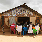 Dadaab's Gambela community, refugees from Ethiopia, pack their church on a Sunday till it's overflowing. North Eastern Province, Kenya.