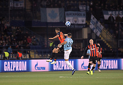 October 23, 2018 - Kharkiv, Ukraine - Forward Junior Moraes (L) of FC Shakhtar Donetsk and defender Nicolas Otamendi (R) of Manchester City FC are seen in action during the UEFA Champions League Group F Matchday 3 game at the Metalist Stadium Regional Sports Complex, Kharkiv, northeastern Ukraine, October 23, 2018. Ukrinform. (Credit Image: © Vyacheslav Madiyevskyy/Ukrinform via ZUMA Wire)