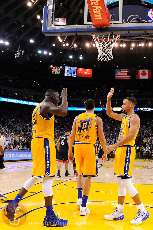 November 17, 2015; Oakland, CA, USA; Golden State Warriors forward Draymond Green (23) and guard Stephen Curry (30) celebrate during the fourth quarter against the Toronto Raptors at Oracle Arena. The Warriors defeated the Raptors 115-110.