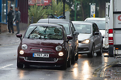 ©Licensed to London News Pictures 09/09/2019.<br /> Chislehurst ,UK. Headlights on in the afternoon. People out and about in the wet weather in Chislehurst High Street, Chislehurst, South East London.The Met office has issued a yellow weather warning as thunderstorms are expected across parts of the UK. Photo credit: Grant Falvey/LNP