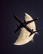 Alaska Airlines Boeing jet transits the Moon.