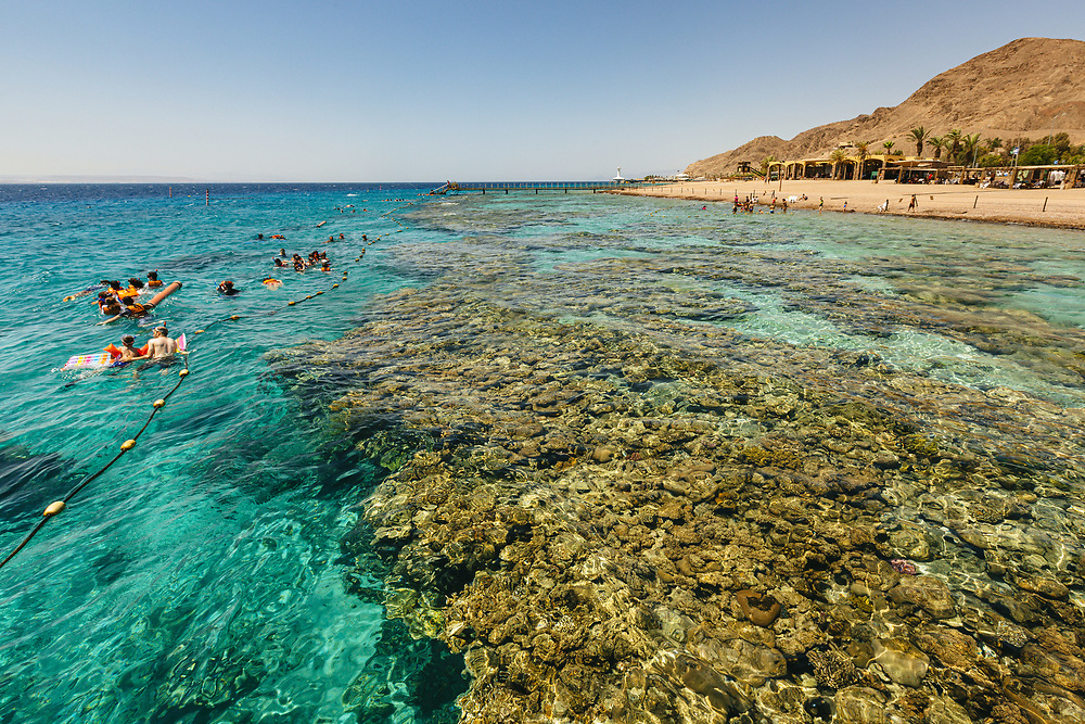 People are seen swimming and snorkeling at Coral Beach Nature Reserve in Eilat, Israel's southernmost city, at the northern tip of the Red Sea, on the Gulf of Aqaba